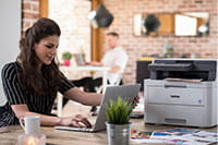 Woman sat with printer on desk