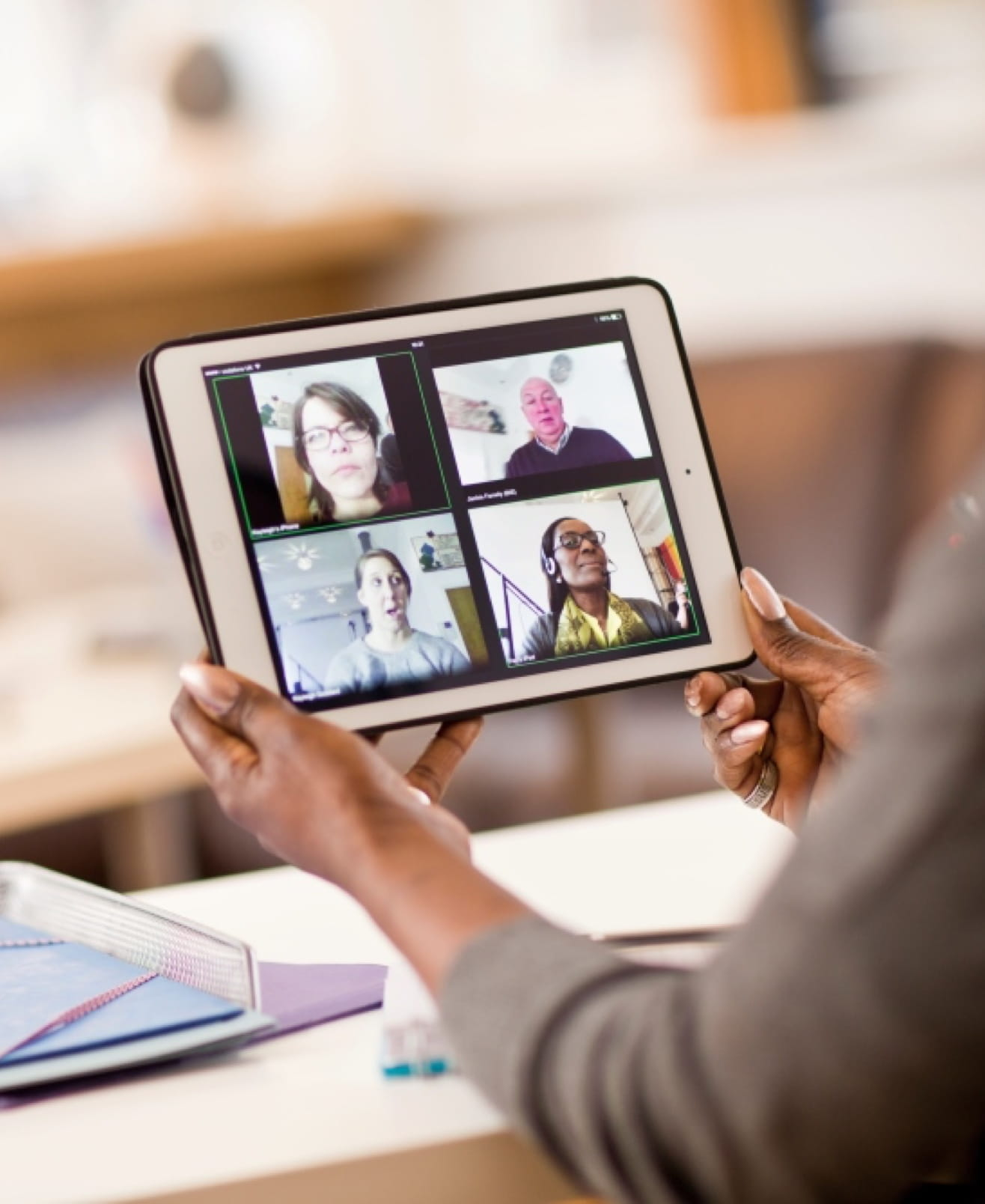 A woman uses OmniJoin web conferencing, video conferencing and online meeting software on an iPad