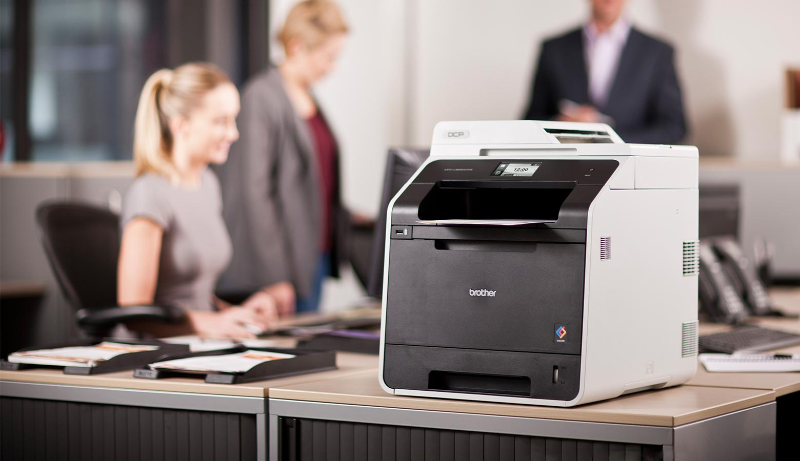 A Brother laser printer being used in an office
