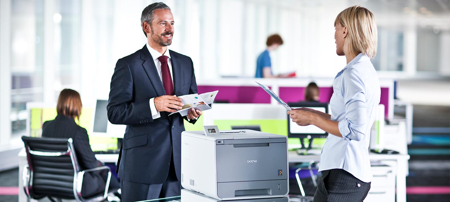 Staff in a busy office using printsmart with their Brother printers