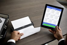 Man with iPad printing to brother mobile printer wirelessly