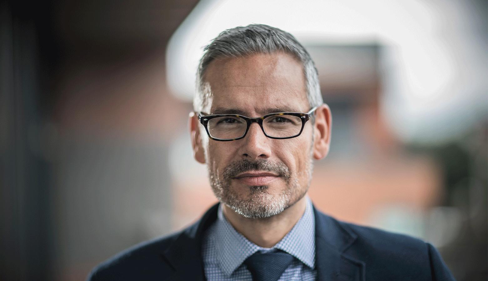Man holding glasses