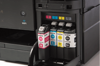 Ink cartridge cover open on Brother printer revealing genuine Brother supplies