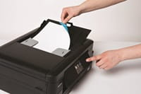 Person feeding document into Brother multifunction printer