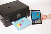 Person printing colour document on Brother printer from tablet computer