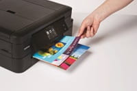 Person removing colour prints from Brother printer