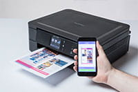 Black inkjet printer with colourful output and mobile phone - DCP-J772DW