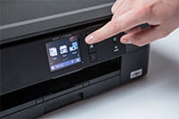 Black inkjet printer with finger touching touchscreen - DCP-J772DW