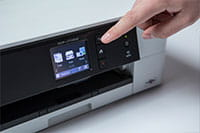 White inkjet with finger pointing out touchscreen
