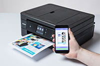 black inkjet printer printing colourful document from a mobile device - MFC-J890DW