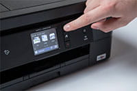 Black inkjet printer with finger pointing to touchscreen - MFC-J890DW