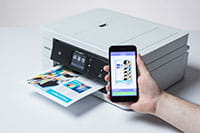 White printer printing colourful document from mobile device
