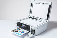 White inkjet printer printing colourful document with copier lid open - MFC-J985DW
