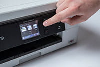 White inkjet printer with finger pointing to touchscreen - MFC-J895DW