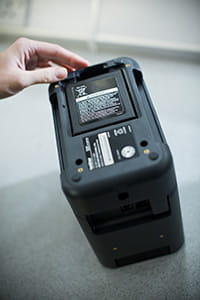 Brother PT-P900W label printer with battery base and rechargeable battery being installed
