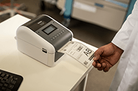 Doctor printing medical label using Brother TD-4550DNWB desktop label printer