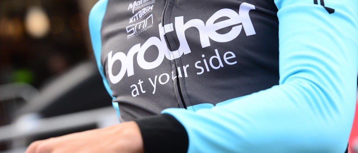 cycling kit with Brother logo across the chest