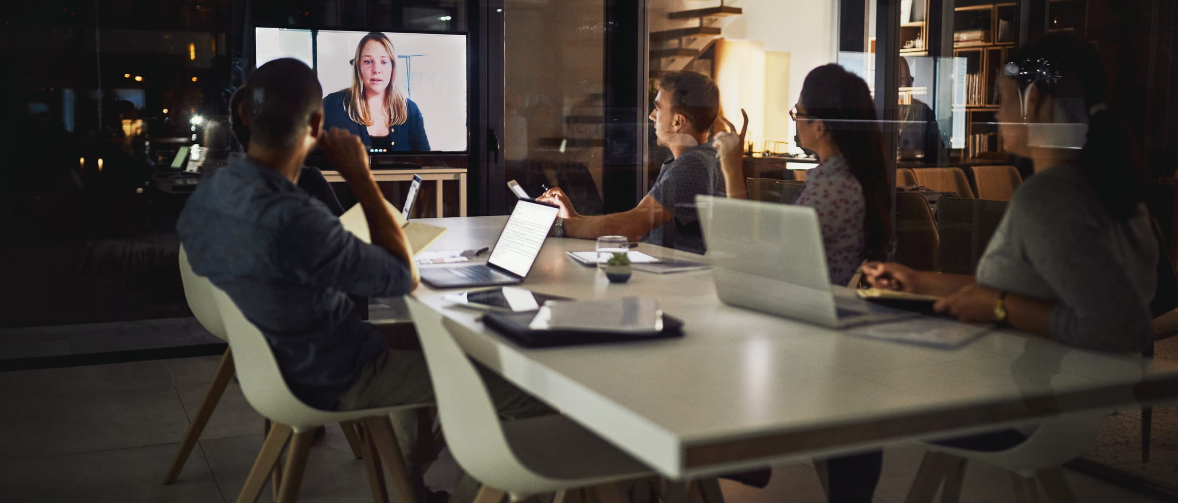 Small medium business employees improve collaboration by using web conferencing to speak to a colleague on a screen