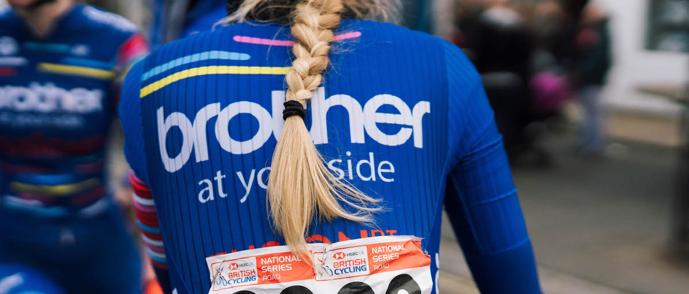 Close-up of Brother UK-FusionRT cyclist's back wearing team jersey