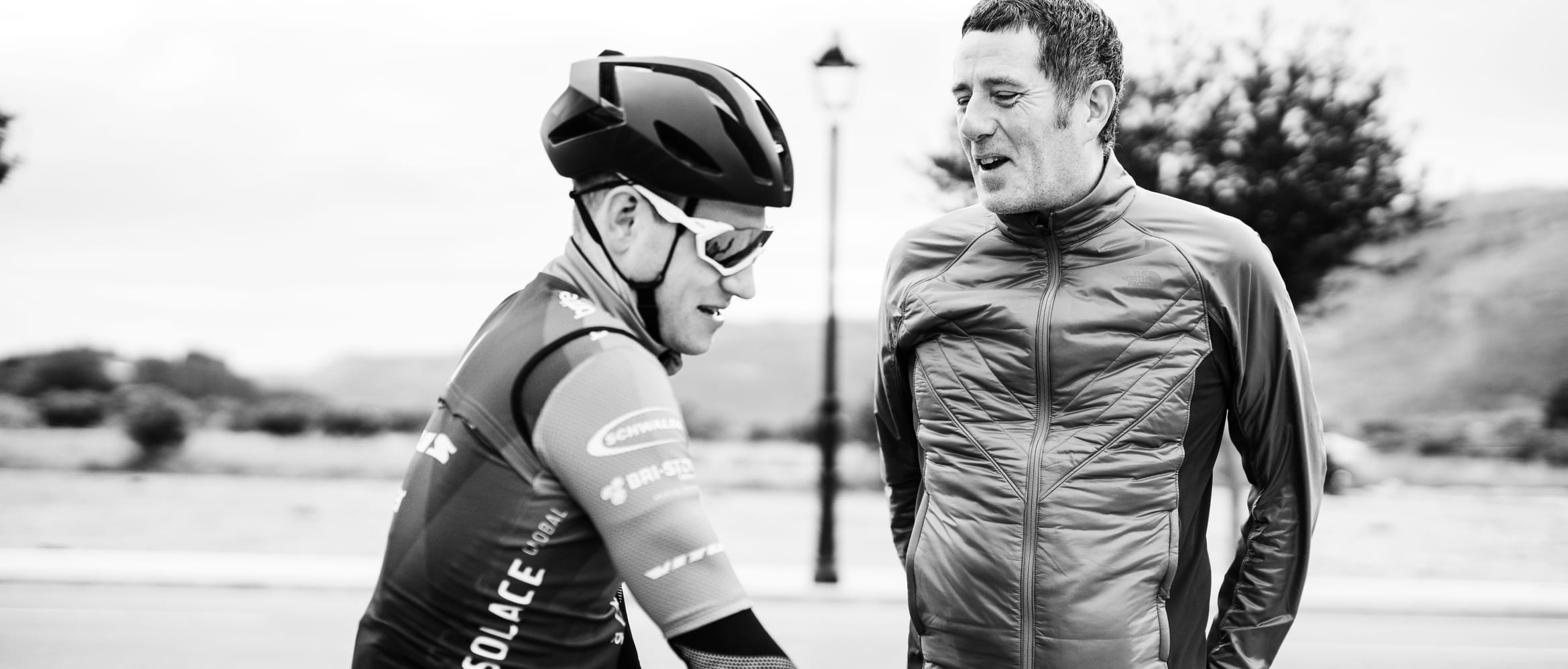 Phil Jones MBE talking to a cyclist