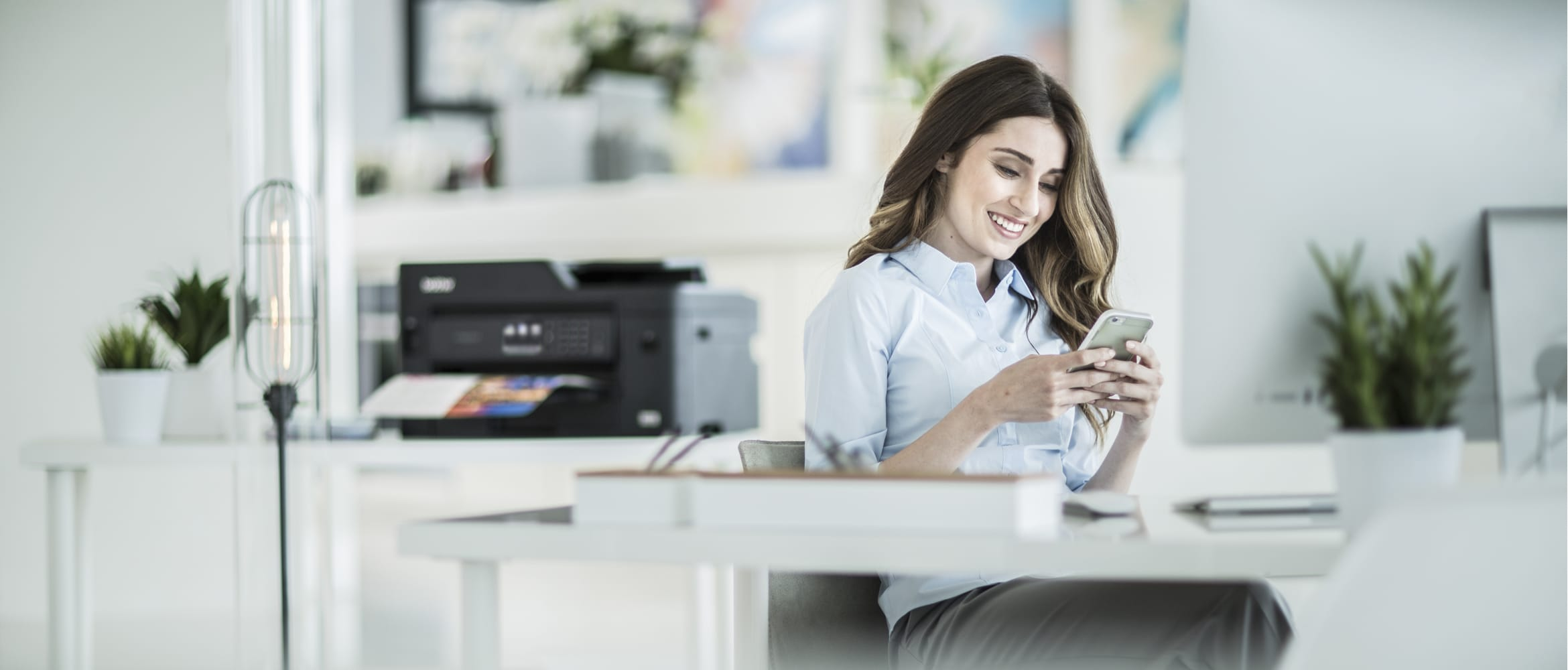 A lady printing a document from a smartphone in a home office environment