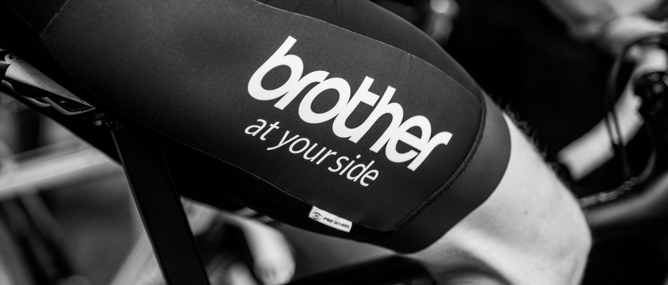 cyclist peddles in Brother branded kit