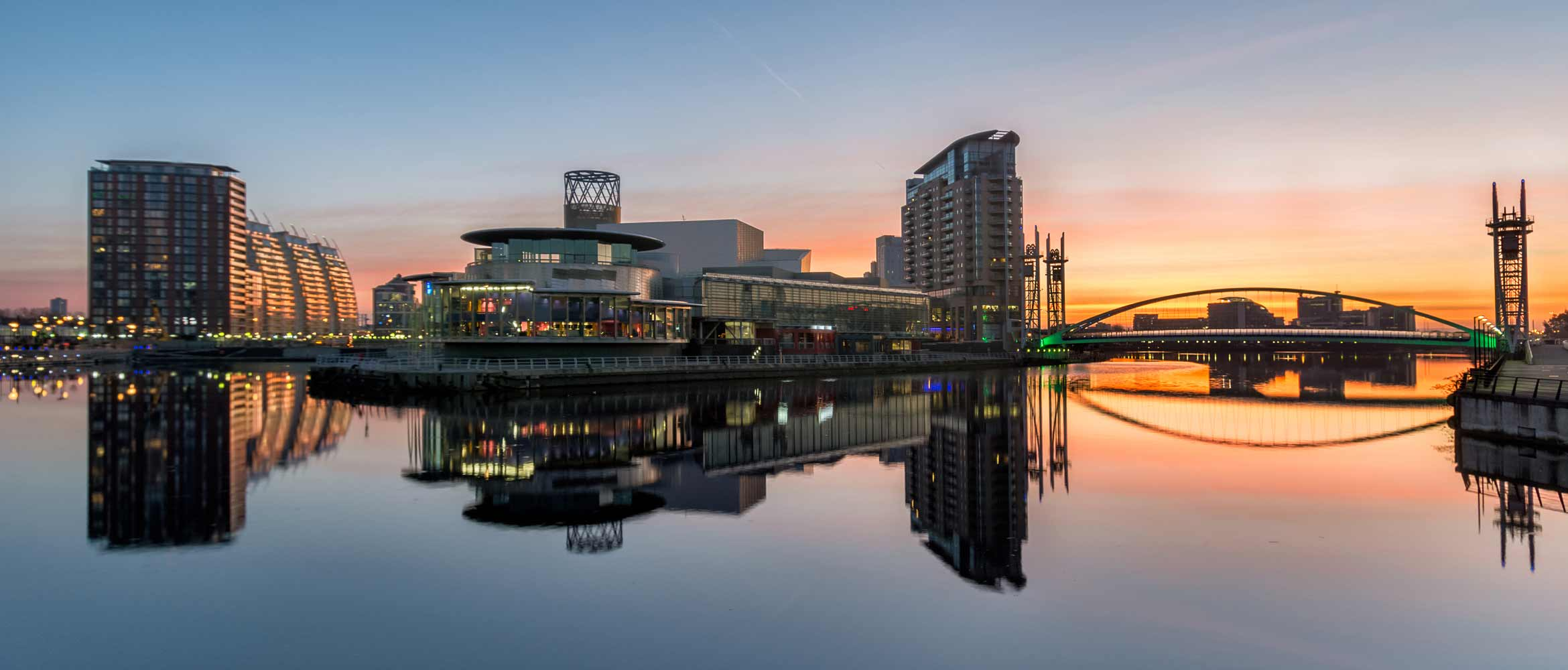 Sunrise at Salford Quays with reflections