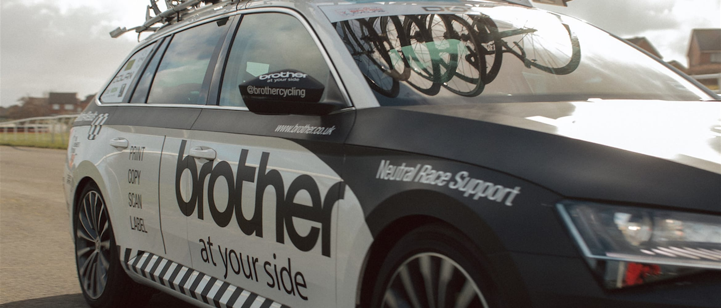 Side view of Neutral Service race support vehicle showing Brother At Your Side livery