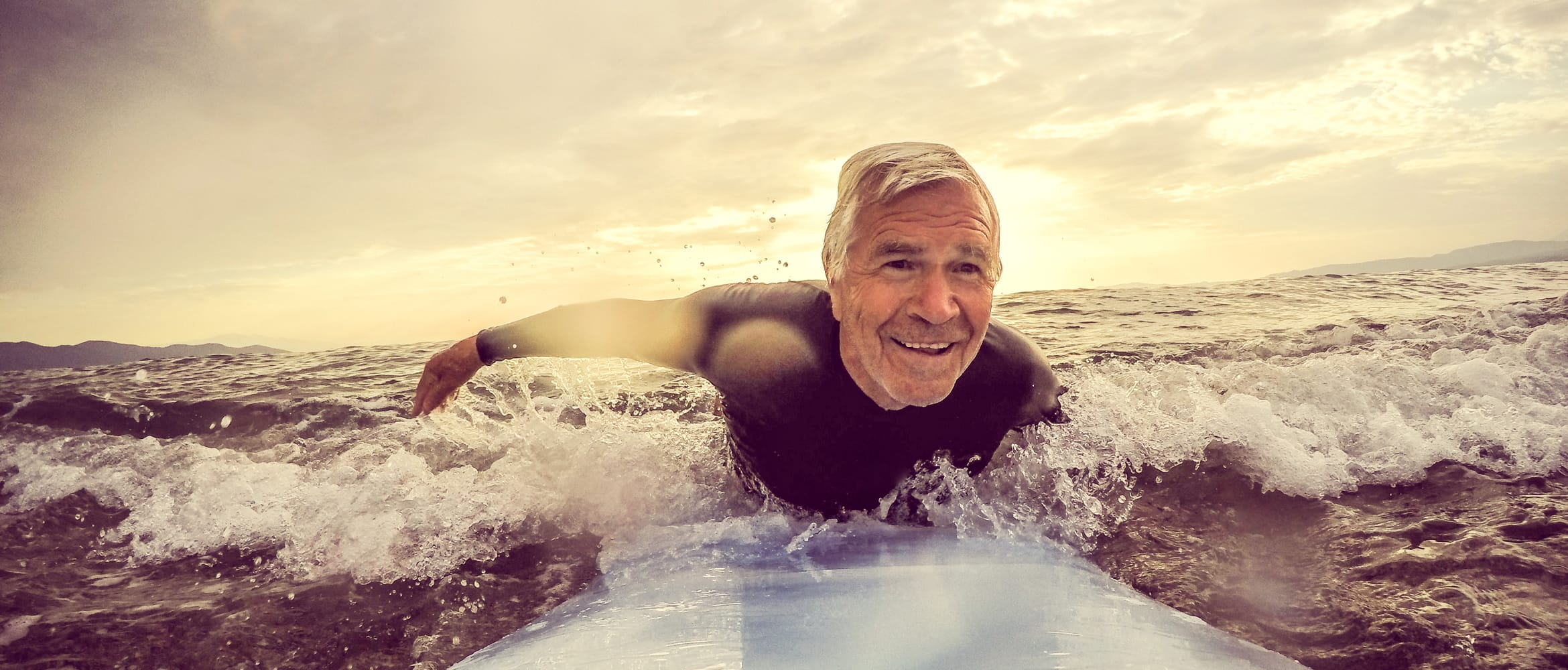 older man surfing