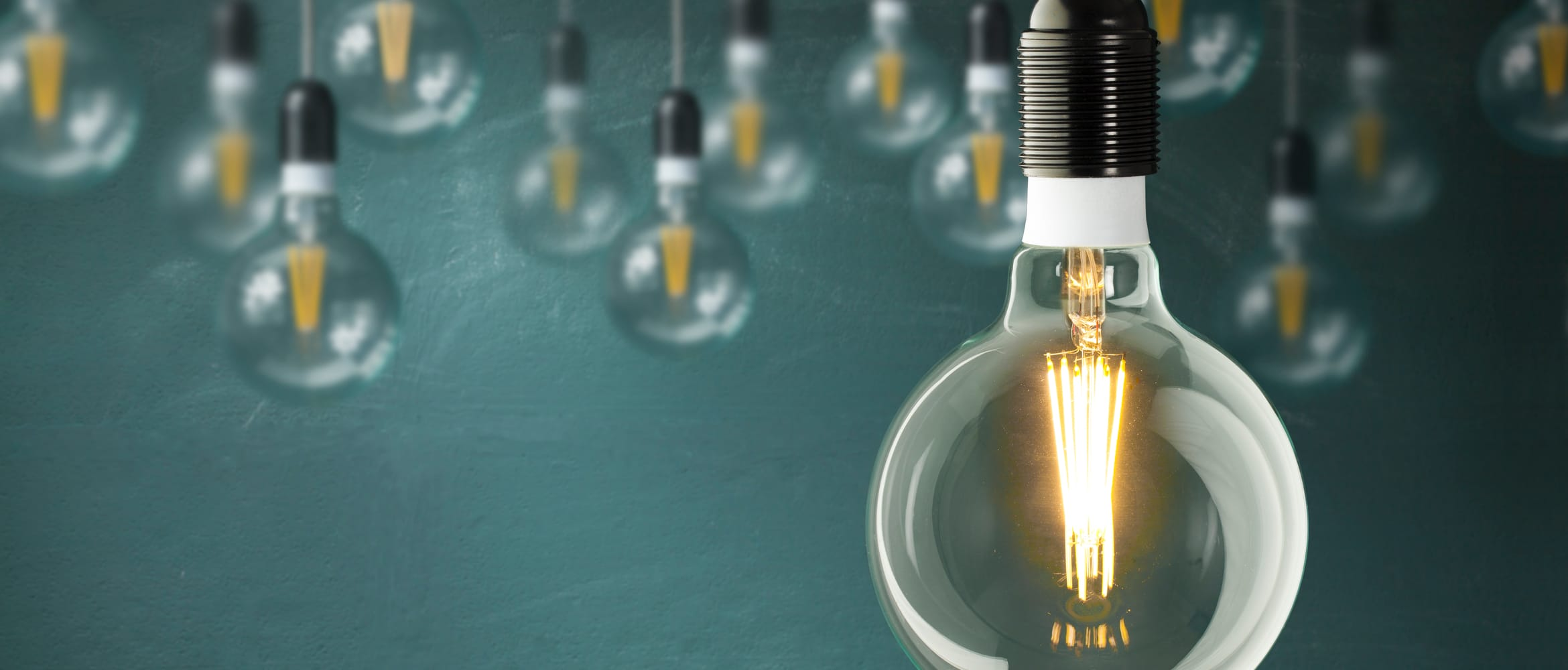 close up of a glowing light bulb to signify good business ideas