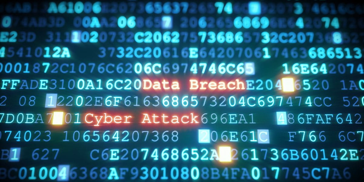 """computer code spelling out """"data breach, cyber attack"""""""