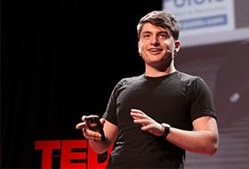 Josh Valman performs a TED talk