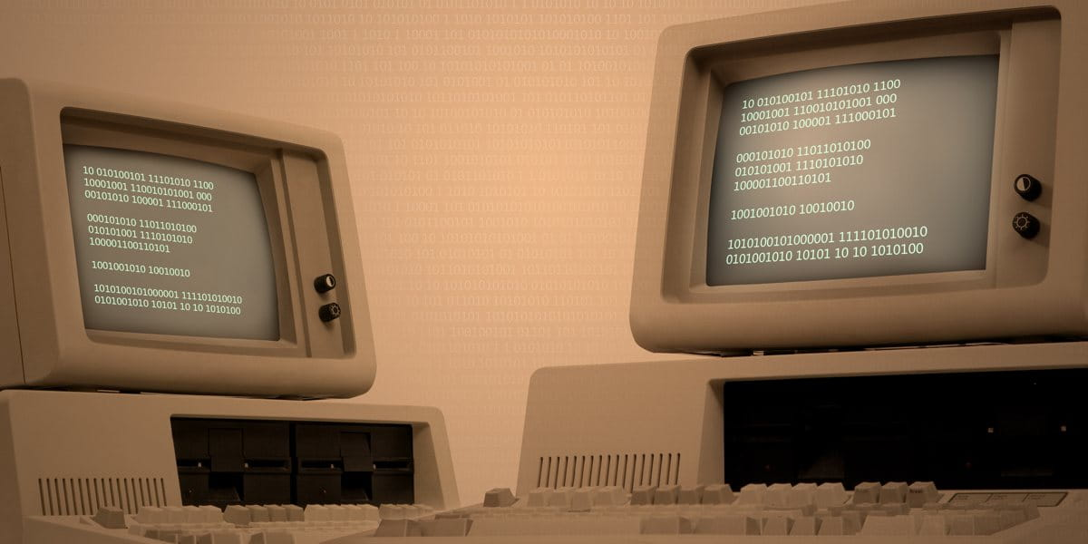 two retro computers showing legacy technology systems within education