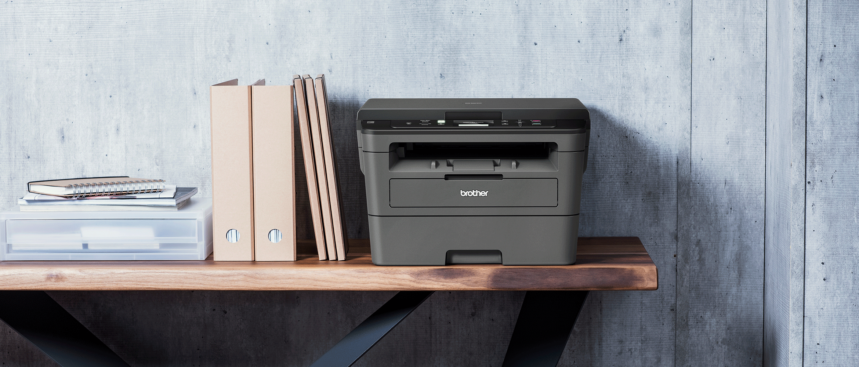 Mono laser Brother printer on a shelf