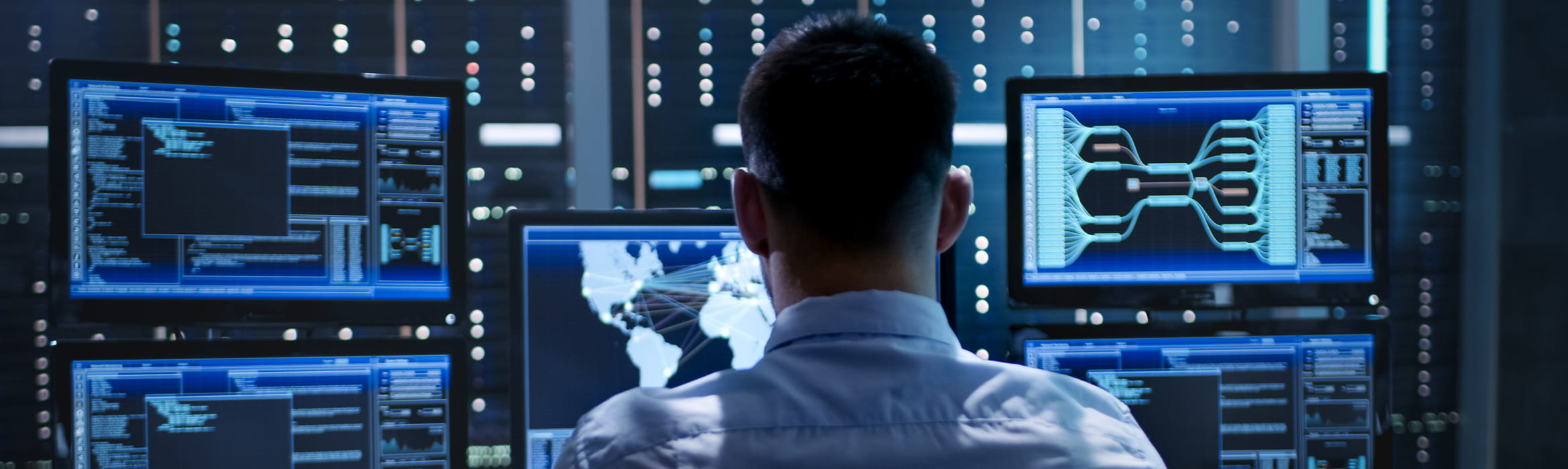 System security specialist sat at system control centre