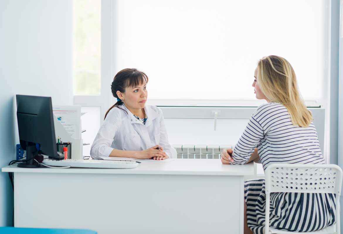 Doctor chatting to a patient