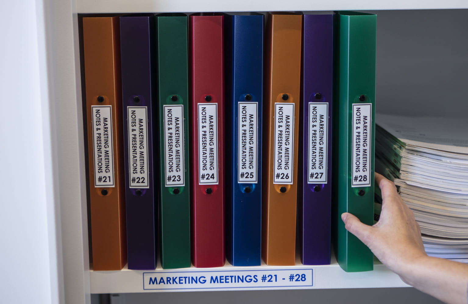 File folders in a cabinet clearly labelled using a durable Brother P-touch label