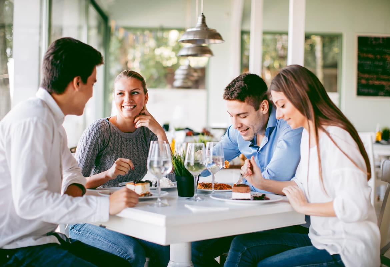 Friends enjoying dinner in a restaurant