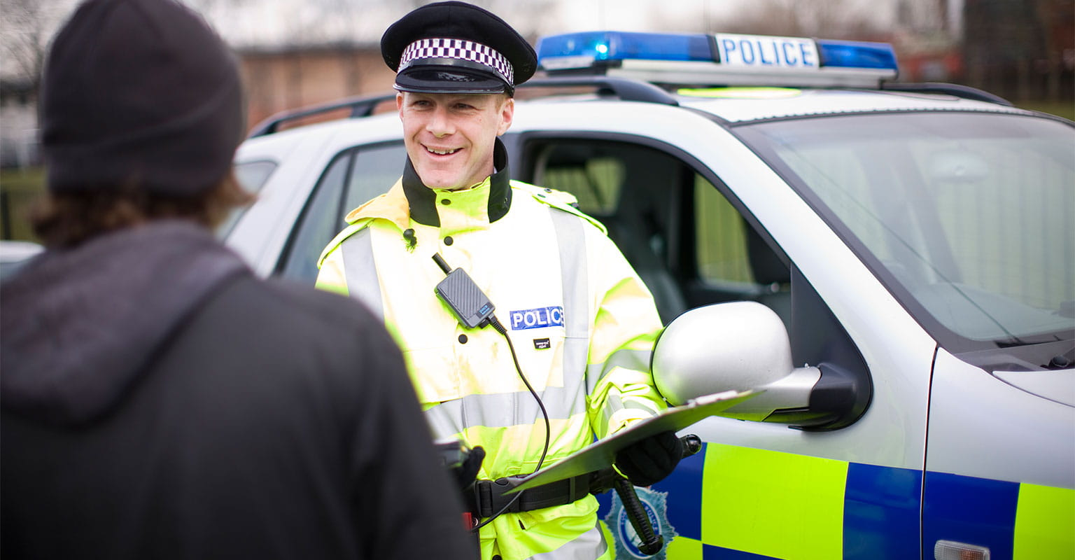 Police officer using a Brother portable printer to issue a ticket