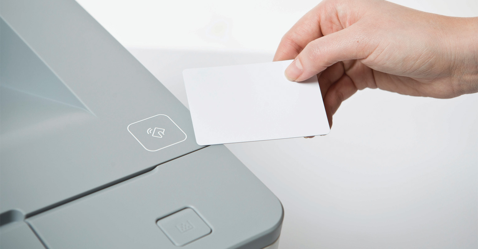 Swiping an ID card to login to a printer