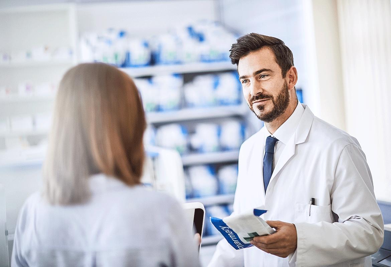 Pharmacy employees working