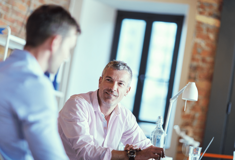Two businessmen talking in an office