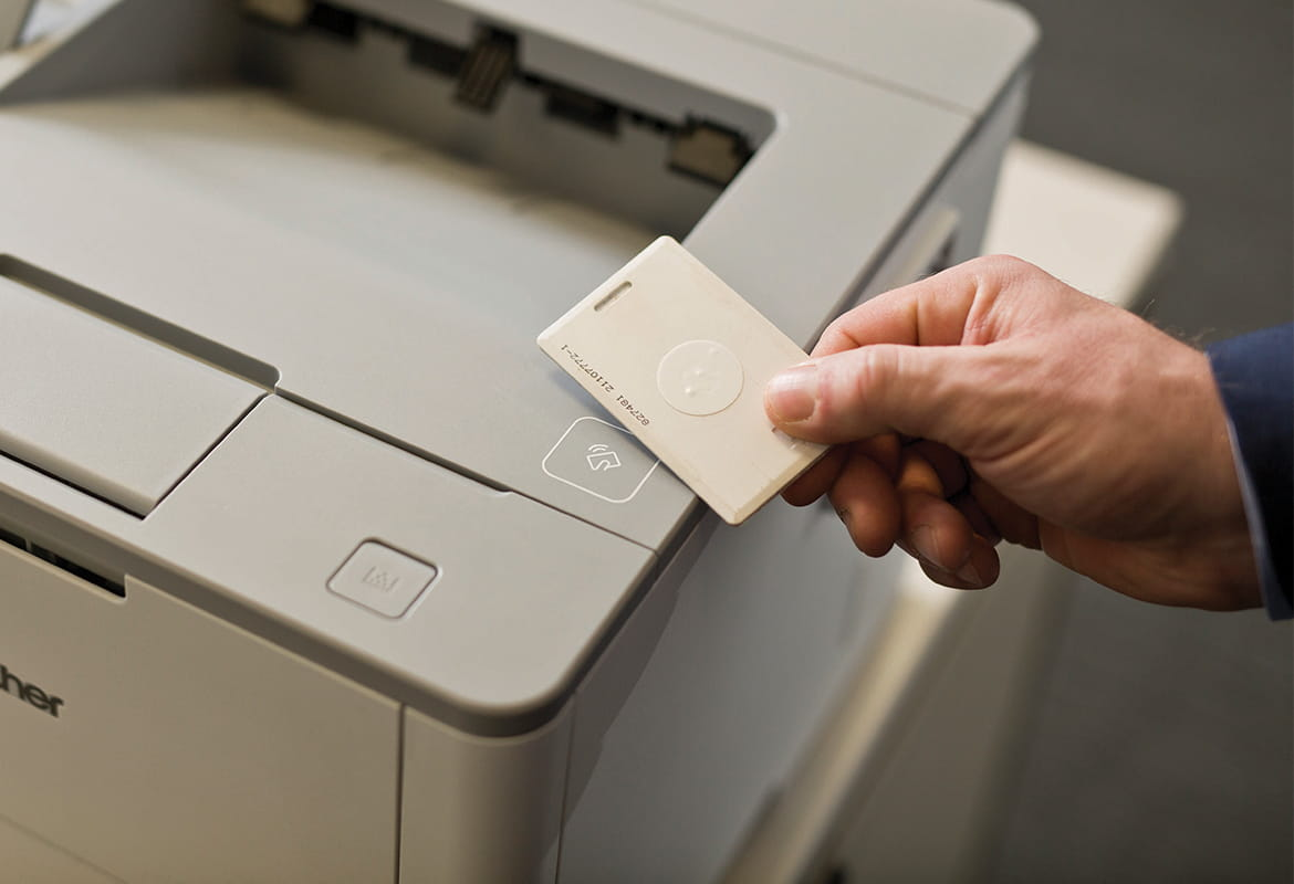 Printer with integrated NFC allowing print job to be released by authenticated user