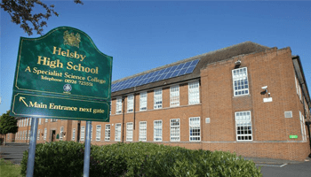 Helsley High School sign in front of building