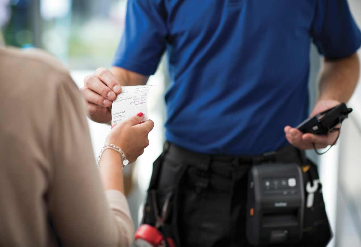 Man handing over a receipt printed from a Brother mobile printer