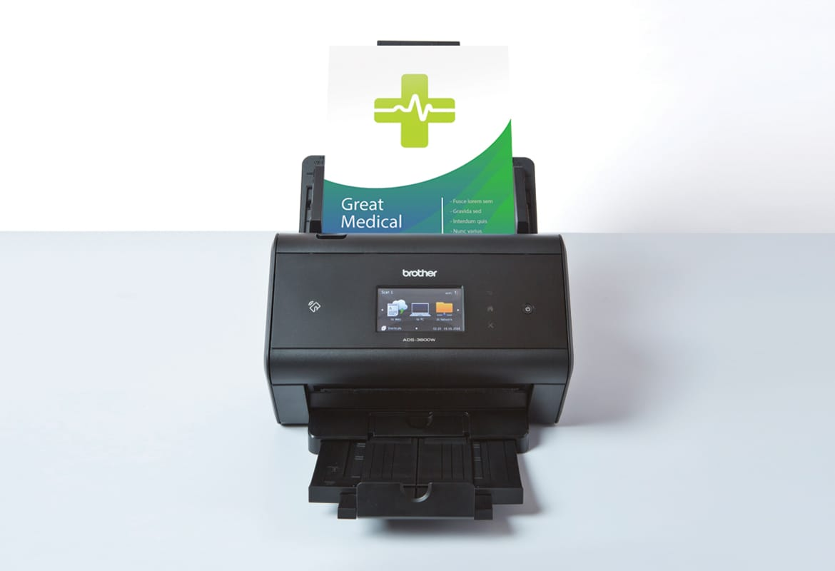 ADS Brother scanner on white background with medical document scanning