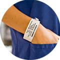 Brother TD labelling machine shows patient wristband label in healthcare sector
