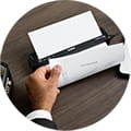 Brother Pocket Jet Mobile Printer shown printing A4 business document