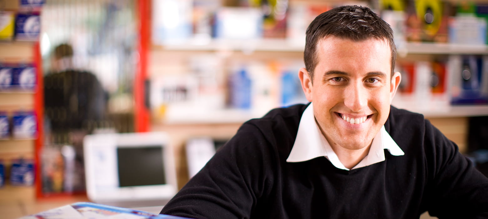 Man smiling in a retail environment