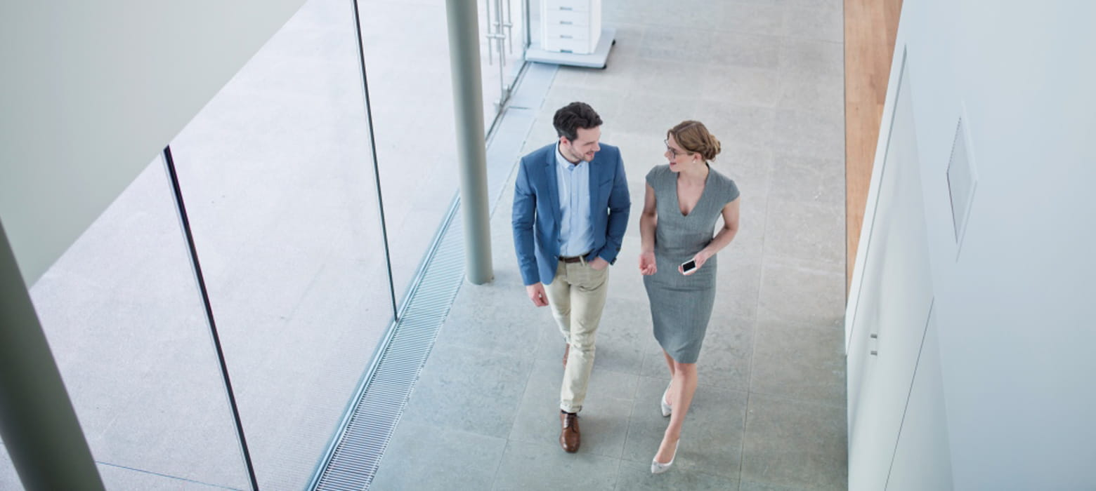 Man and woman chatting in corridor